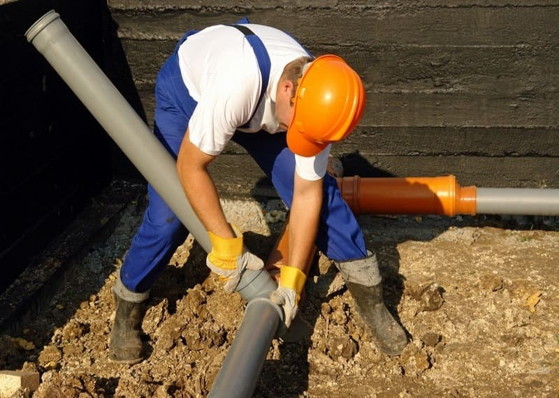 Plumbing contractor working on sewer line repair service in Edwards, CO