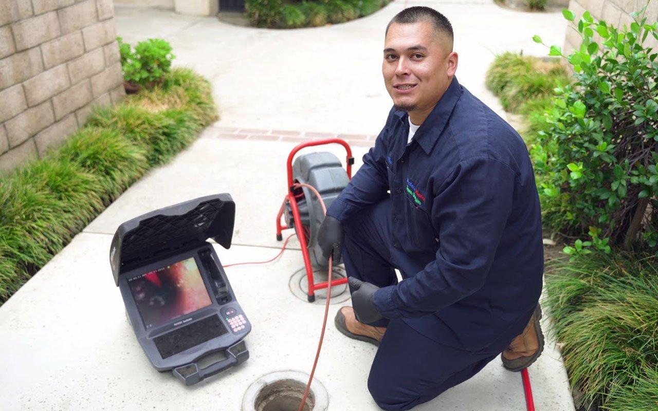 Technician inspecting plumbing system