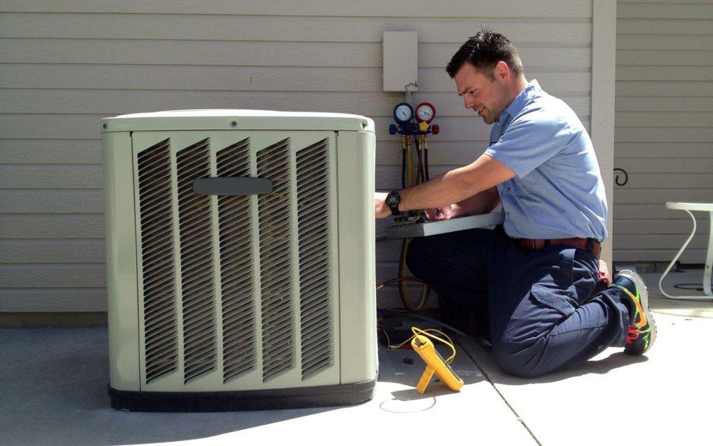 HVAC installation worker installing HVAC unit