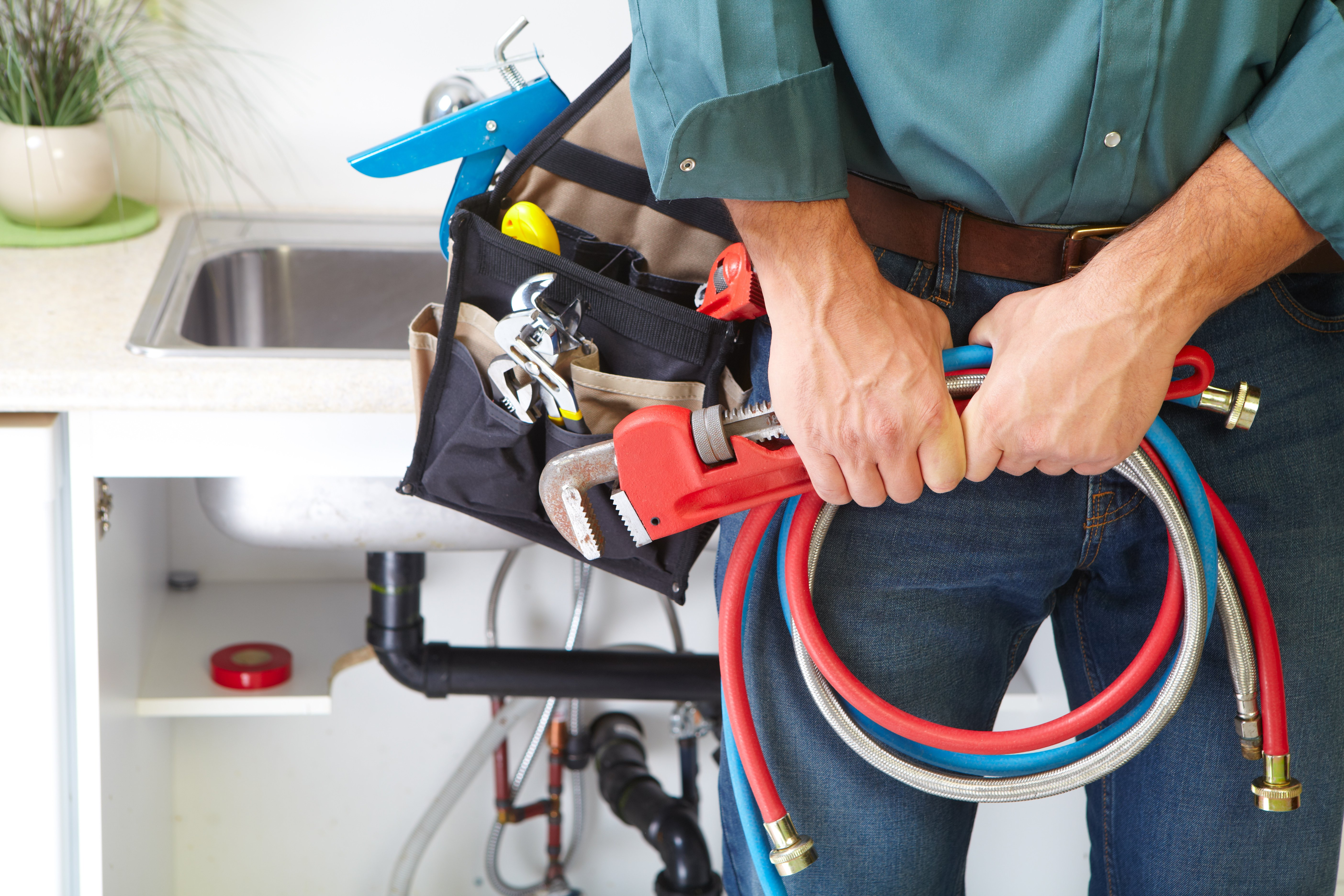 Plumber with tools and equipment for emergency plumbing services