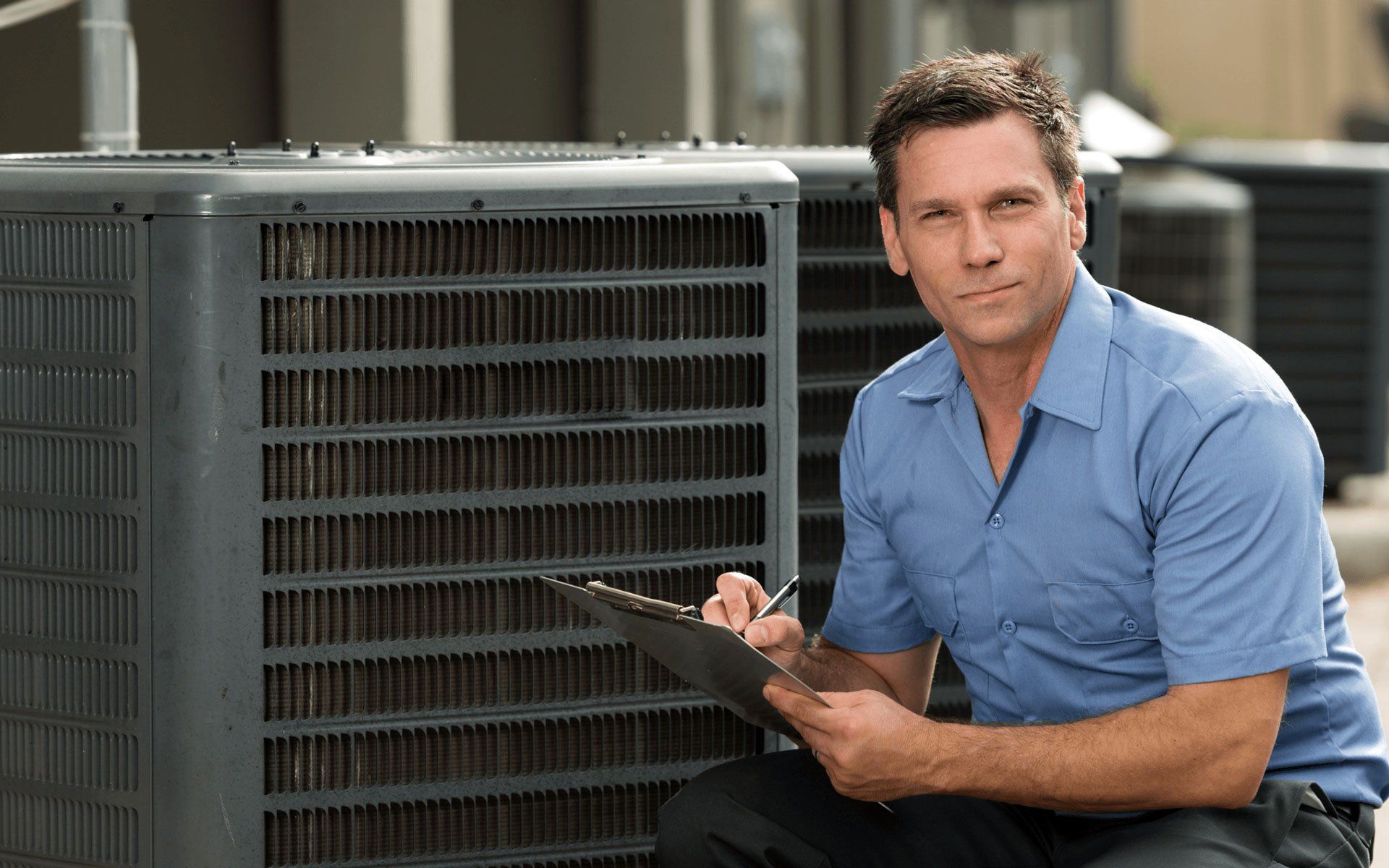 HVAC installation technician carrying out HVAC installation works