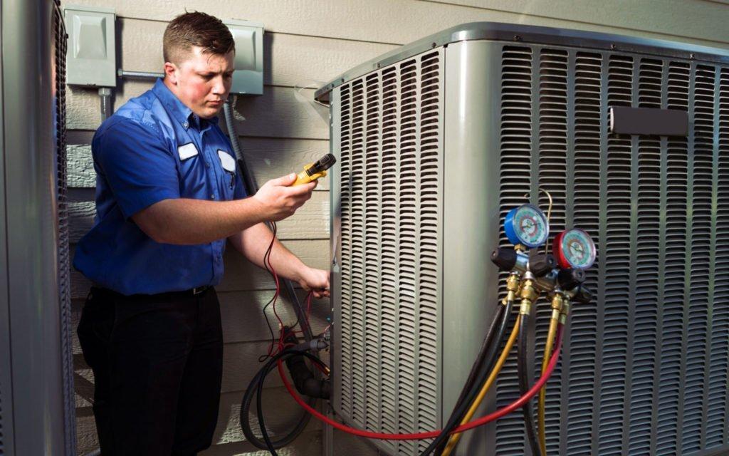 HVAC repair technician checking HVAC's electrics