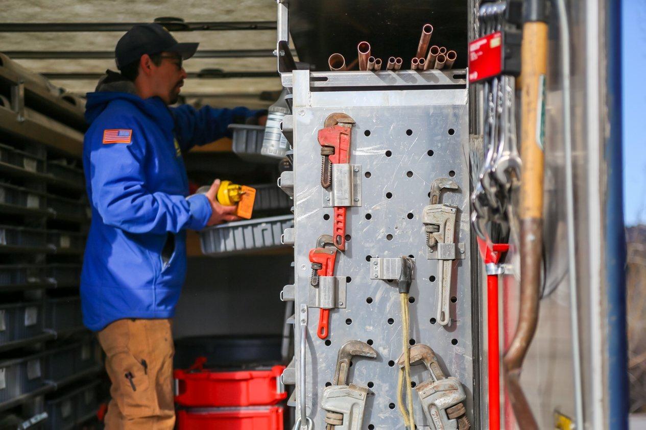 PSI Technician looking or plumbing parts