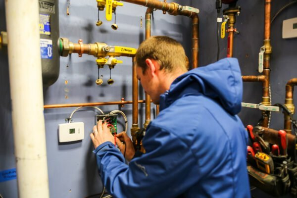 PSI Technician working on heating system