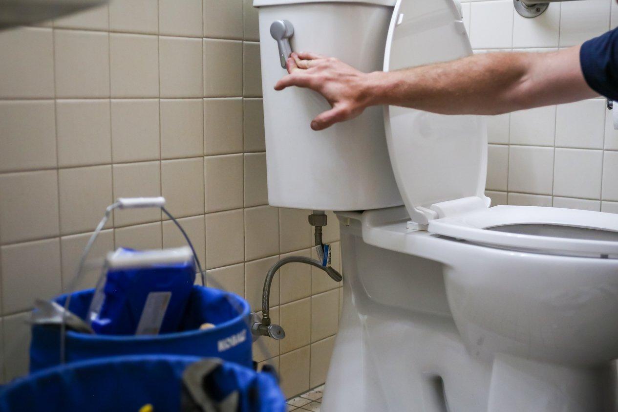 PSI Technician Working on Toilet