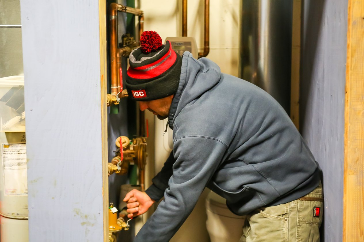 PSI worker working on valves- Leak detection